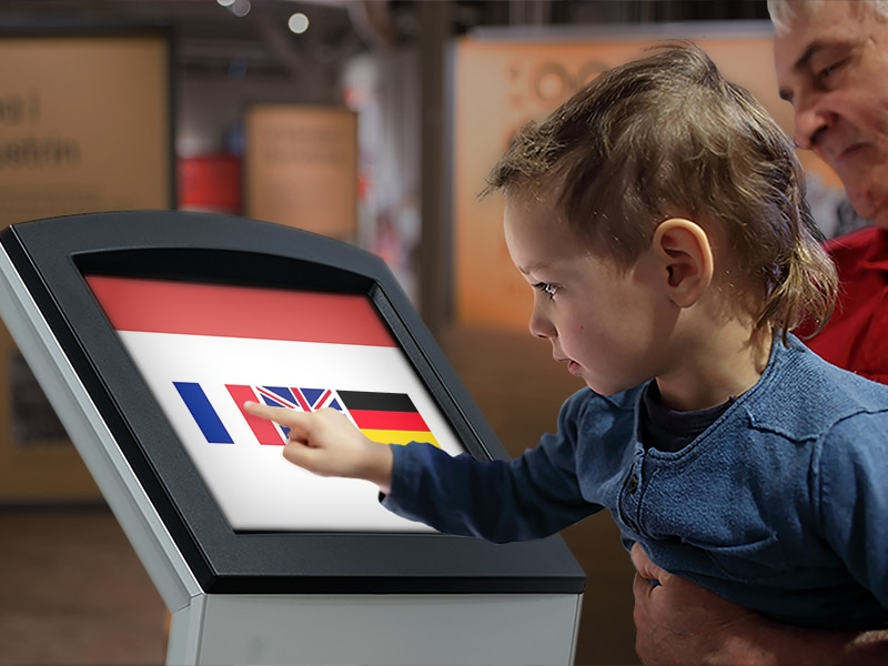 Visitor buying ticket at self-service ticket kiosk