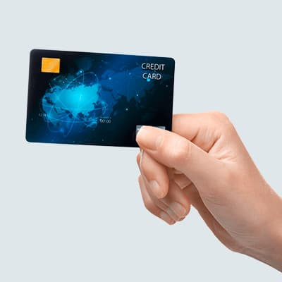 Hand holding blue credit card