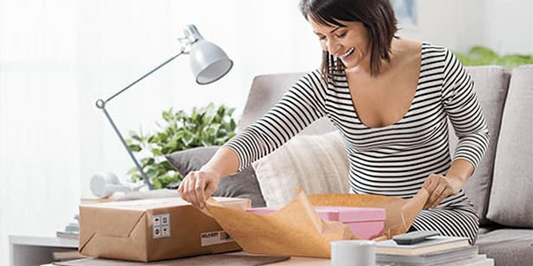 NP Ecommerce - Woman unwrapping a package