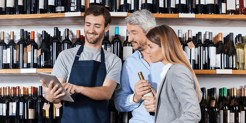 mPOS is being used by a wine dealer to excite two customers
