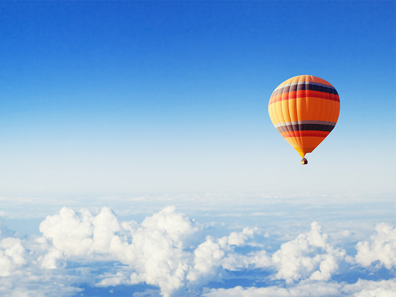Air baloon above the clouds illustrating POS in the cloud