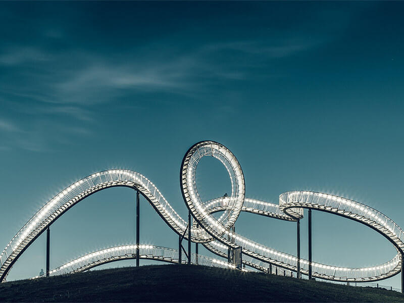Roller coaster lighting up at night